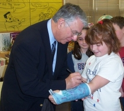 US Congressman Donald Manzullo signs a short arm cast.  (Photo: Wikipedia)
