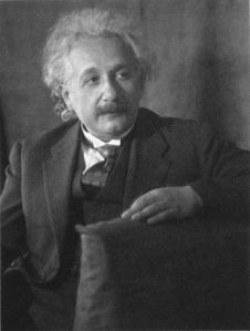 Albert Einstein, half-length portrait, seated, facing right Inscribed on mat: Mrs. Eugenie Meyer zum Andenken an ihren Besuch in Caput [i.e. Caputh] am 15.VIII.31. Albert Einstein.  Source:  Wikimedia.  Public domain.
