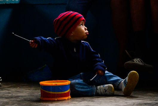 A young boy plays with a toy drum that was given to him during Joint Task Force-Bravo's visit to at the Sisters of Charity Orphanage in Comayagua, Honduras, Jan. 25, 2015. The Sisters of Charity Orphanage is one of seven different orphanages from around the Comayagua Valley that the U.S. military personnel assigned to JTF-Bravo have supported over the past 17 years. In addition to spending time with interacting with children, members have also collected and donated much-needed supplies and food, as well as helped in minor construction work on the buildings in which the children live. (U.S. Air Force photo/Tech. Sgt. Heather Redman). Source: Wikimedia. Public domain.